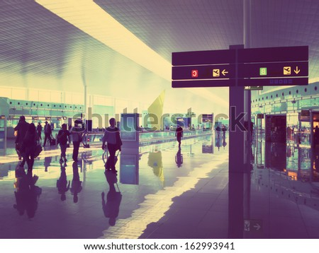 Airport hall with an information display, in a retro style - stock photo