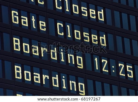 Airport information board, gate closed and boarding announcement. - stock photo