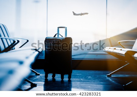airport interior with flying airplane outside,chongqing china. - stock photo