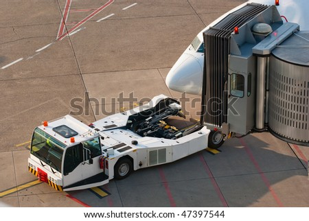 Airport. Jet and towing truck. - stock photo