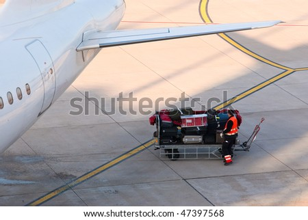 Airport. Luggage prepared for loading into the airplane. - stock photo
