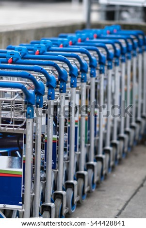 Airport luggage trolleys