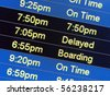 Airport monitors displaying flight status - stock photo