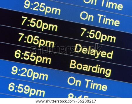 Airport monitors displaying flight status - stock photo