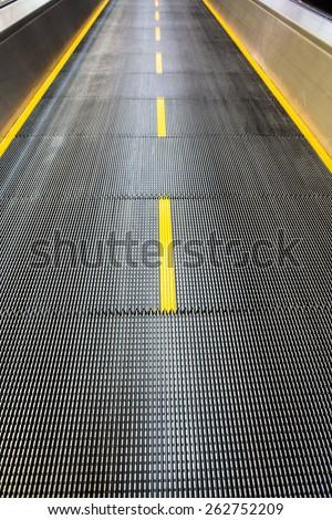Airport moving sidewalk also travelator, walkalator and movator. - stock photo