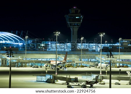 airport night jet plane transport airline city - stock photo
