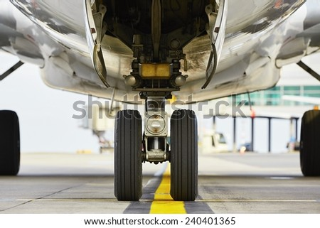 Airport - nose wheel of the aircraft - stock photo