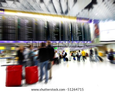 Airport passengers in a departure terminal with schedule display - stock photo