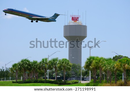 Airport radar with plane taking off - stock photo