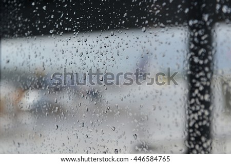 airport, rain drops on the window - stock photo
