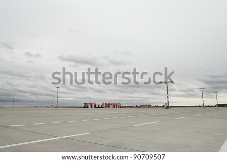 Airport runway and bad weather - stock photo