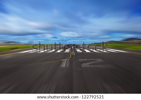 Airport Runway During a Takeoff - stock photo