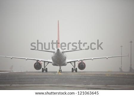 Airport runway in bad weather, Prague - stock photo