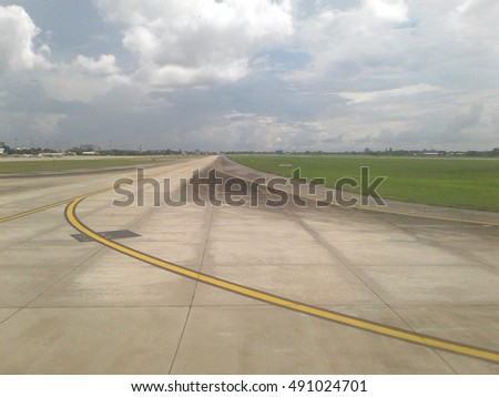 Airport runway on a cloudy