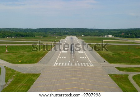 Airport runway on landing approach. Taken from cockpit of small private plane. - stock photo