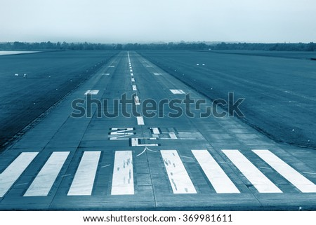 Airport runway with marking. Technical blue colored. - stock photo