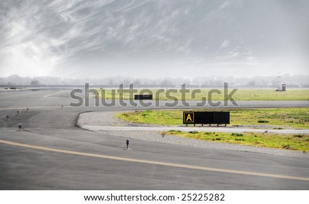 Airport Runway with storm clouds