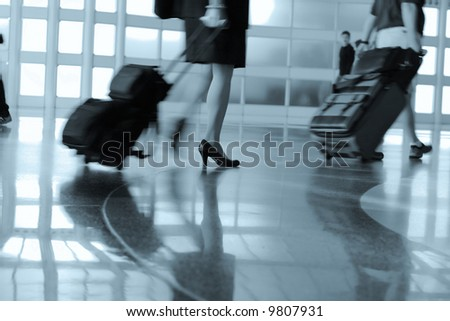 airport rush blur motion silhouette legs - stock photo
