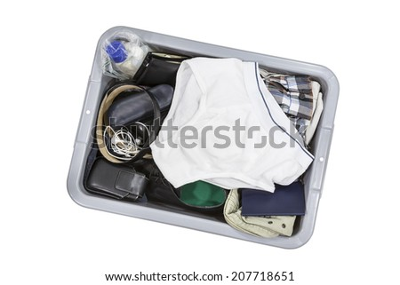 Airport screening tray with travel items and underwear.   - stock photo