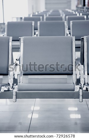 airport seats row, black and white toning - stock photo