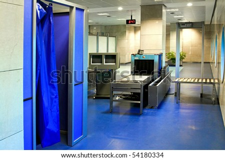 Airport security check with strip search cabin - stock photo