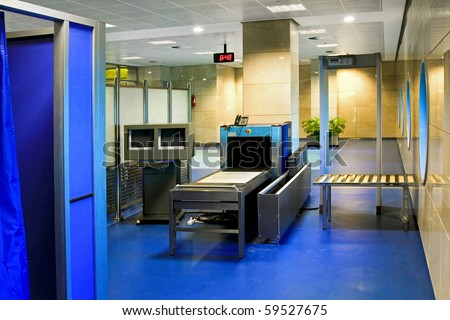 Airport security screening with X ray metal detector - stock photo