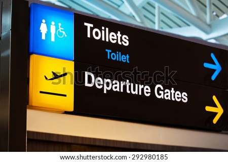 Airport sign for toilets and departure gates  - stock photo