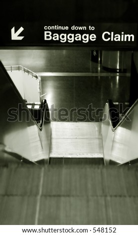 Airport signs: to the baggage carousel - stock photo