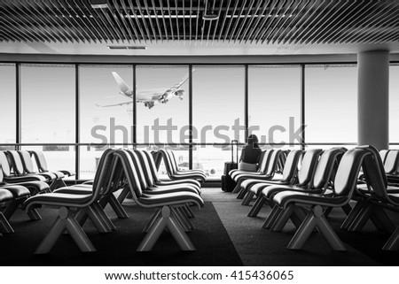 airport sitting.airport interior.airport black and white.airport and plane.airport chair.airport waiting.airport seat - stock photo