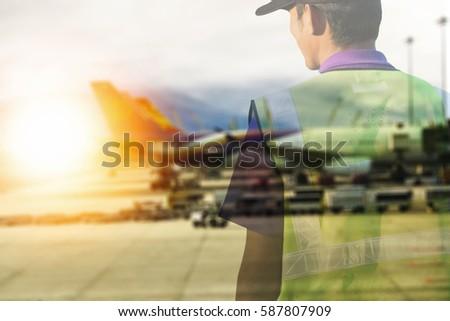 airport staff looking at aircraft