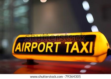 Airport Taxi sign illuminated at night - stock photo