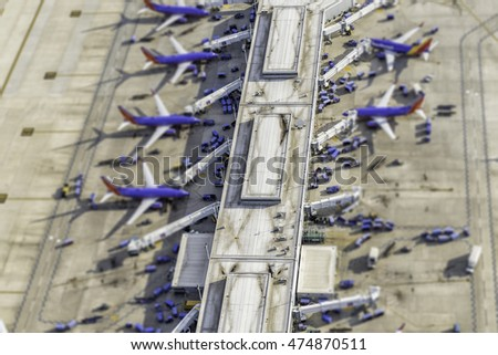 Airport terminal aerial view with planes. Tilt shift effect