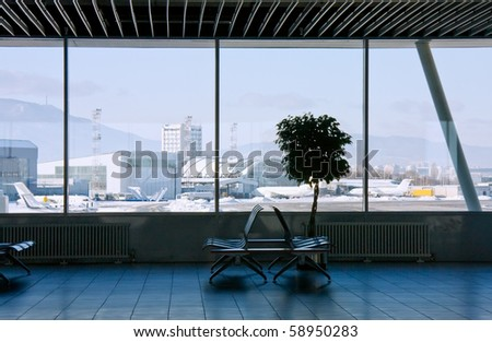 Airport terminal and view to mountain panorama from the window. International airport of Sofia, Bulgaria - stock photo