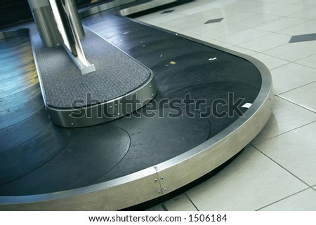Airport terminal empty luggage belt - stock photo