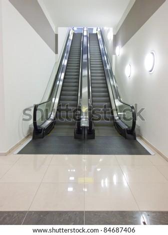 Airport terminal escalator two directional - stock photo