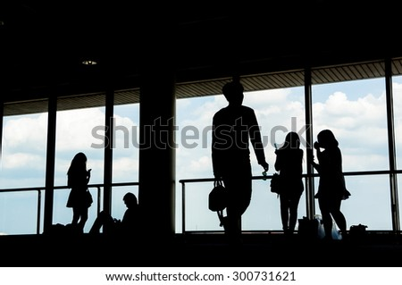 Airport terminal hall. Waiting travelers