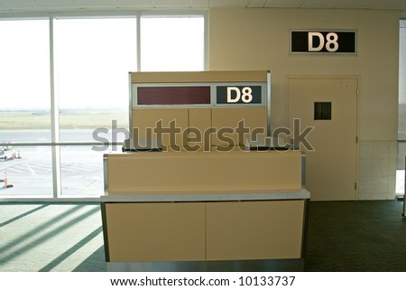 Airport terminal interior with gates and waiting area - stock photo