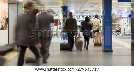 airport terminal, passengers walking to and from check-in  - stock photo