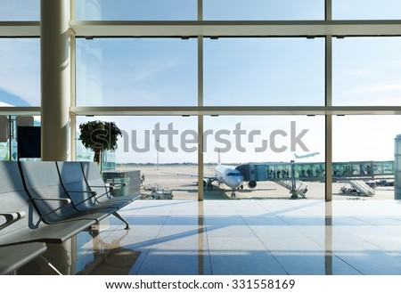 Airport terminal, people going to airplane in background - stock photo