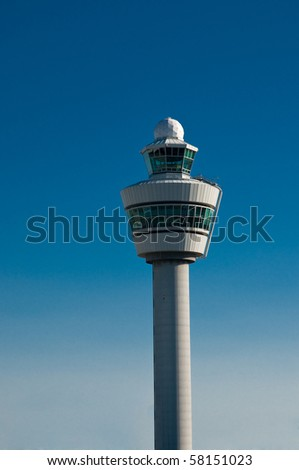 Airport tower at Schiphol airport in the Netherlands against blue sky - stock photo