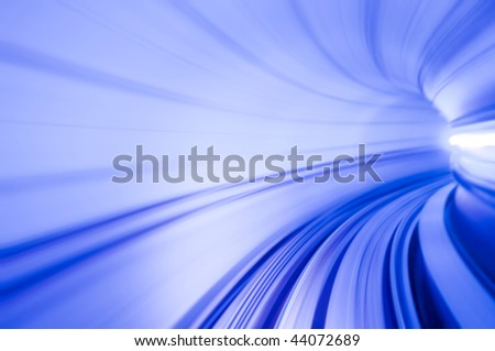 Airport Transit. Photo looking in front of an airport train inside tunnel. - stock photo