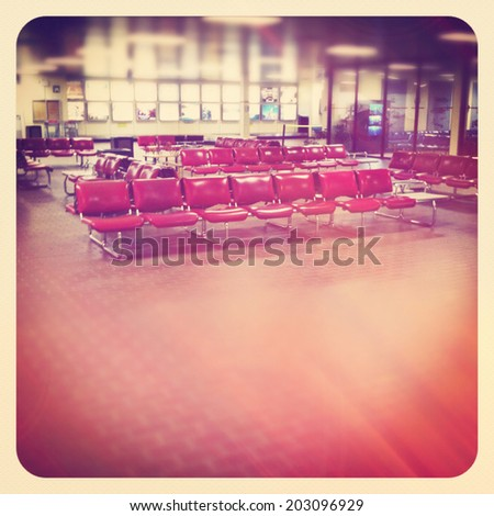Airport waiting area with seating - instagram - stock photo