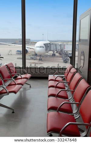 Airport. Waiting room and plane - stock photo