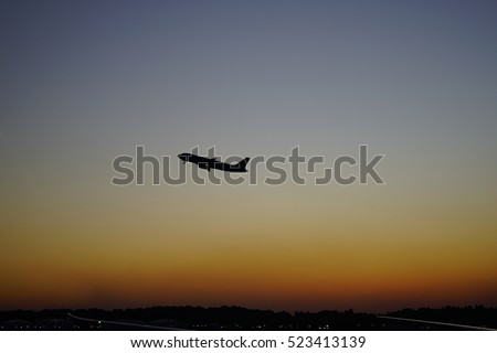 Airport with airplane at beautiful sunset