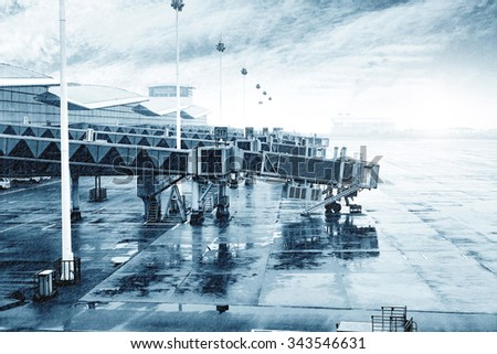 Airports in heavy rain outside the window, awaiting flights - stock photo