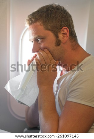 Airsickness. Man feels very bad on the plane. - stock photo