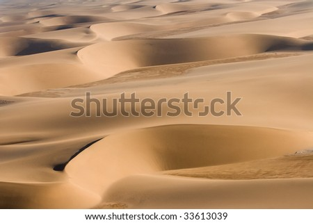 airview of layers of red dunes - stock photo