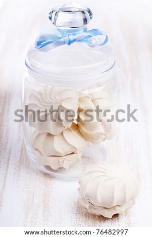 Airy meringue cookies in a jar - stock photo