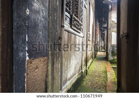 aisle in an ancient chinese folk house building in south east China, photo taken in Lichuan Fuzhou city, Jiangxi Province - stock photo