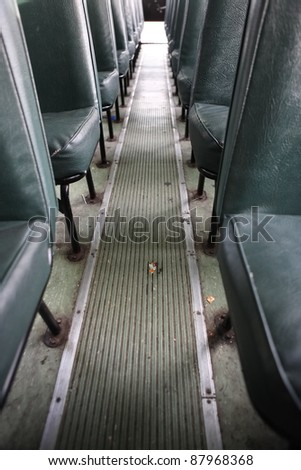 Aisle in Bus with litter - stock photo